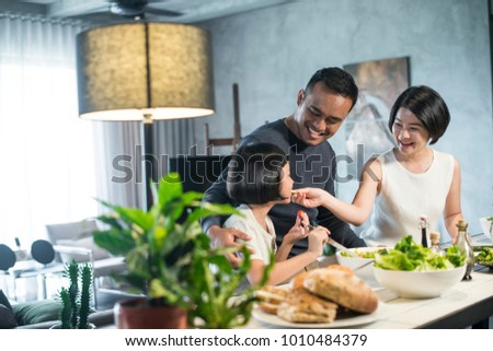 Happy Asian family preparing food in the kitchen. #1010484379