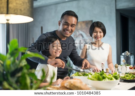 Happy Asian family preparing food in the kitchen. #1010484385
