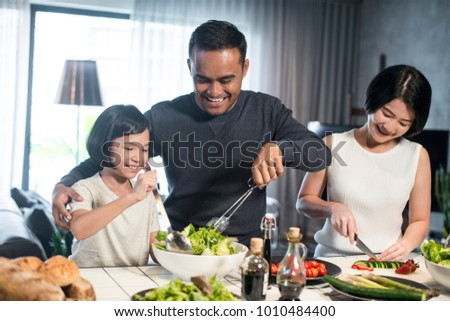 Happy Asian family preparing food in the kitchen. #1010484400
