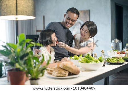 Happy Asian family preparing food in the kitchen. #1010484409