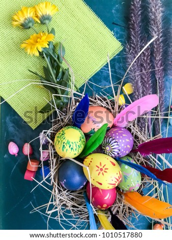 colorful Easter eggs with flowers and feathers #1010517880