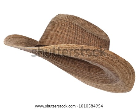 Vintage straw latin american cowboy hat isolated on white background.  Almost straight side view. Tilted up a little, showing the interior. #1010584954