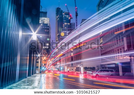 Light trails in the downtown district of London. Long exposure Royalty-Free Stock Photo #1010621527