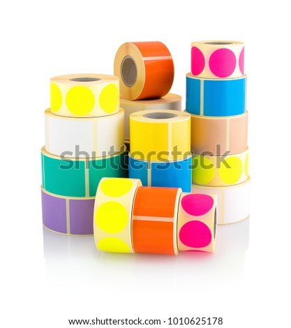 Colored label rolls isolated on white background with shadow reflection. Color reels of labels for printers. Labels for direct thermal or thermal transfer printing. Square and circle labels background #1010625178
