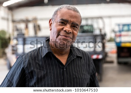 Portrait of Worker on Factory on background #1010647510