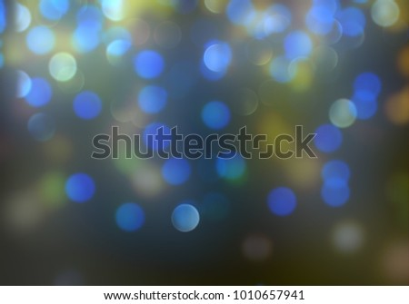 Bokeh abstract texture. Colorful. Defocused background. Blurred bright light. Circular points. #1010657941