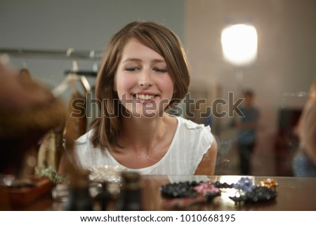 Young woman looking at jewelry #1010668195