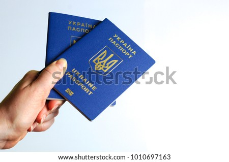 Blue Ukrainian passport in the a woman hands . Isolate #1010697163