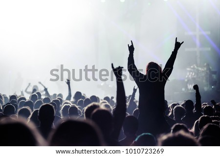 Music fans enjoying rock concert with hand in the air #1010723269