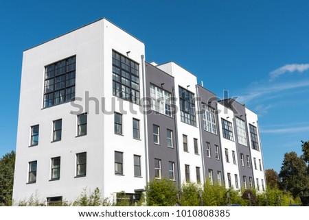 Modern serial houses seen in Berlin, Germany #1010808385
