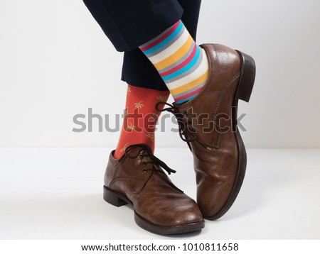 Men's feet in stylish shoes and funny socks #1010811658