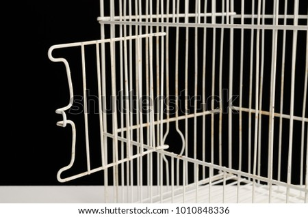 Cage with an open door, a conceptual shot on freedom #1010848336