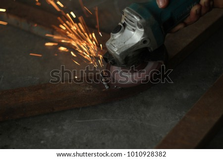 a grinder machine has been used to make the surface of steel with welded joint become flat.  #1010928382