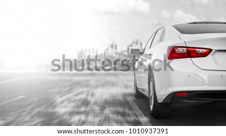 A car accelerating on a highway when traveling to the city #1010937391
