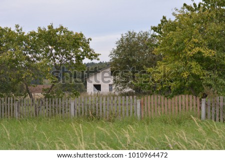 building farm house fence and trees #1010964472