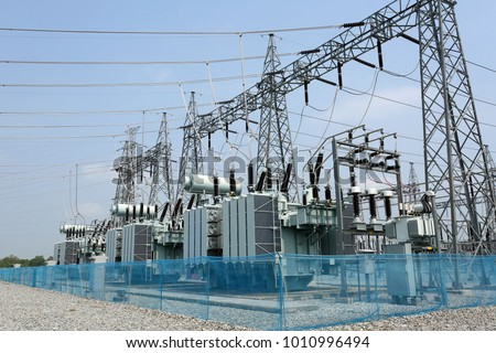 Electrical Transformer : The equipment used to raise or lower voltage, high voltage power station #1010996494