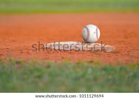 Baseball field Diamond base on green grass Baseline for a baseball sport game #1011129694