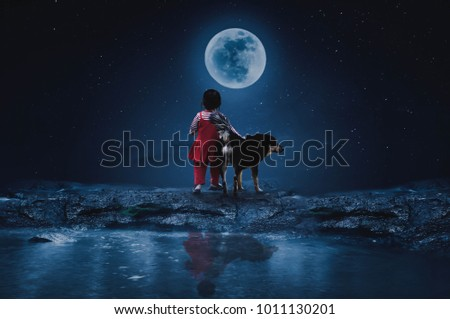 Little Red Riding Hood with a wolf watching the full moon on a lonely night. #1011130201