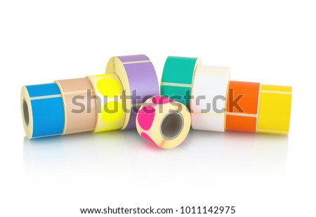 Colored label rolls isolated on white background with shadow reflection. Color reels of labels for printers. Labels for direct thermal or thermal transfer printing. Square and circle labels background #1011142975