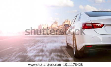 white business car moving on highway #1011178438