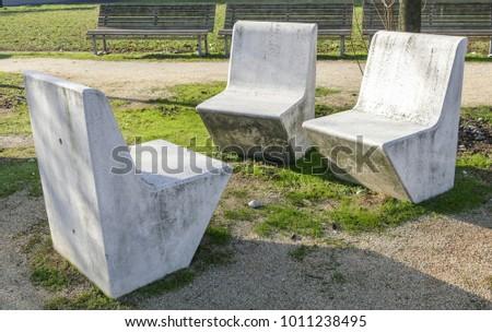 Three Massive Stone Park Bench #1011238495