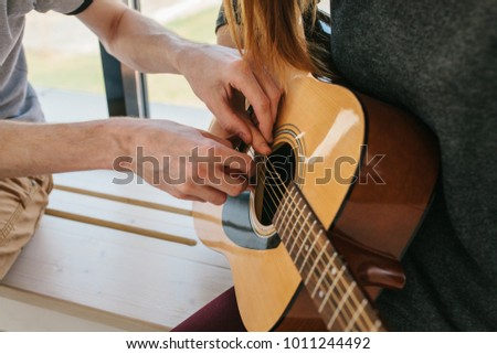 Learning to play the guitar. Music education and extracurricular lessons. #1011244492