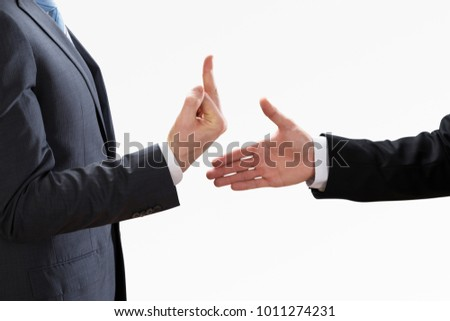 Businessperson Showing Fuck Off With The Middle Finger To The Colleague Shaking Hand #1011274231
