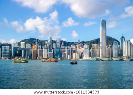 Hong Kong Skyline and Victoria Harbor in morning Royalty-Free Stock Photo #1011334393