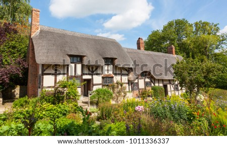 STRATFORD UPON AVON, ENGLAND - AUGUST 9, 2012: Anne Hathaway's (William Shakespeare's wife) famous thatched cottage and garden at Shottery, just outside Stratford upon Avon, England. #1011336337