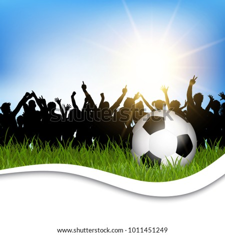 Football / soccer ball in grass with silhouette of cheering crowd #1011451249
