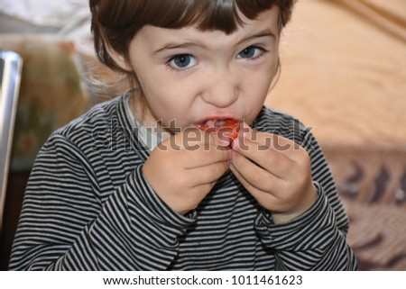 little the child eats strawberries  #1011461623