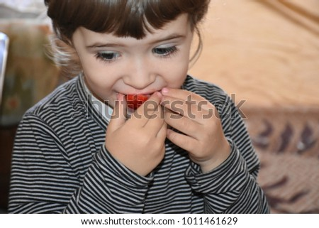 the child eats strawberries  #1011461629