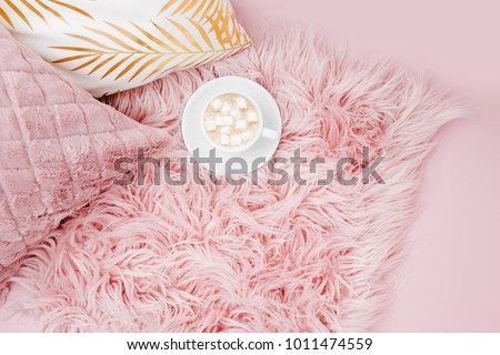 Stylish pink pillows and cup of coffee. Copy space. Flat lay, top view #1011474559