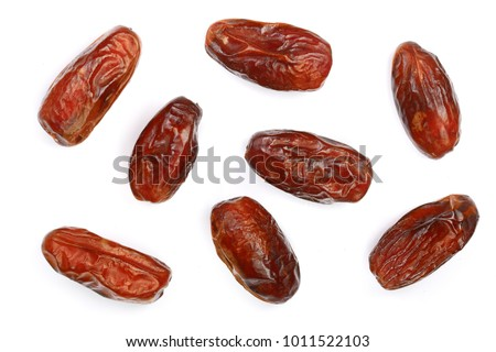 dry dates isolated on white background. Top view. Flat lay pattern Royalty-Free Stock Photo #1011522103