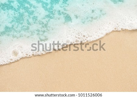 Soft blue ocean wave on the sand background  #1011526006