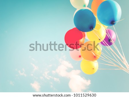 Colorful balloons done with a retro instagram filter effect. Concept of happy birth day in summer and wedding, honeymoon party use for background. Vintage color tone style #1011529630