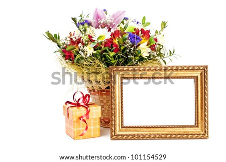 Gift box and golden picture frame with flowers on white background