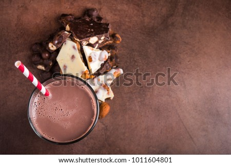 tasty cocoa drink with chocolate dessert bar on stone table, top view #1011604801