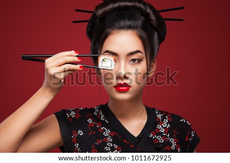 Asian woman eating sushi and rolls on a red background. 8 - Eight March, Black Friday, Setsubun Japanese Festival, sushi sale.