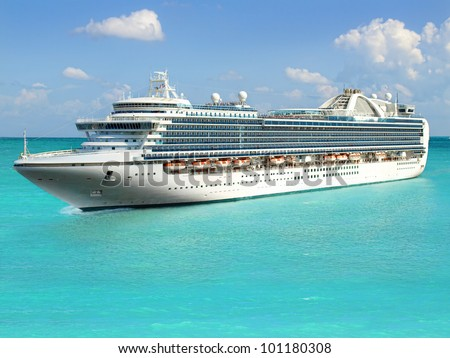 Luxury cruise ship sailing from port Royalty-Free Stock Photo #101180308