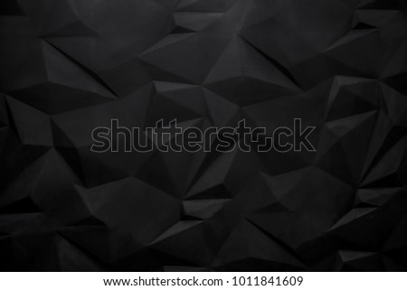Black abstract polygonal background wall. Soft focus.