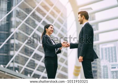 Business partnership marketing meeting concept. Image businessmans handshake. Successful businessmen handshaking after good deal.vintage color, Discussing Together Startup Idea.Working Online Project Royalty-Free Stock Photo #1011910321