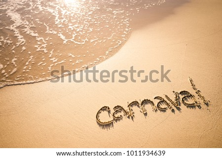 Message for Carnaval written on smooth sand beach in Rio de Janeiro, Brazil