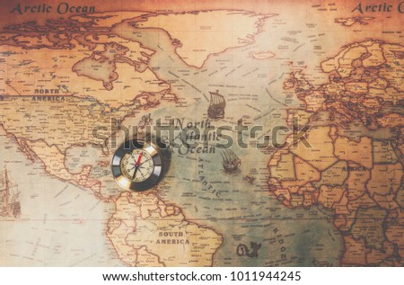 Columbus day and world map with compass #1011944245