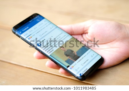 January 21, 2018 Bangkok, Thailand Women use mobile internet application facebook on smartphone Facebook is social networking service.She uses the internet to get information of the world. #1011983485