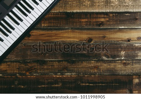 Electronic piano on the wood table