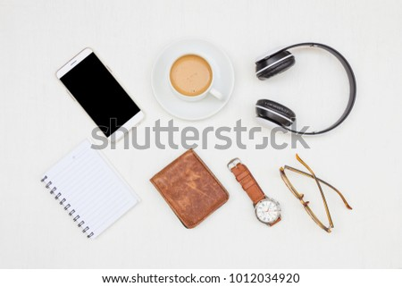 Men's accessories, essential travel items with hot coffee on white rustic wooden background #1012034920