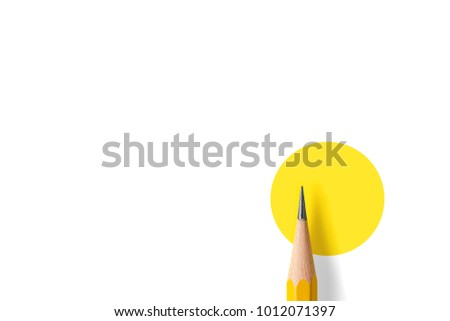 Minimalist template with copy space by top view close up macro photo of wooden yellow pencil isolated on white texture paper and combine with yellow circle. Flash light made smooth shadow from pencil. #1012071397