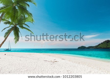 The white sand beach in Thailand,southern Andaman . This picture was taken in summer time.