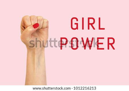 A woman hand on a pink background and inscription Girl power #1012216213